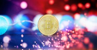 Investment platform with charts and bitcoin coin. Bitcoin BTC Cryptocurrency Coins. Stock Market Concept