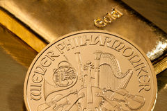 Investment in real gold than gold bullion and gold. Coins royalty free stock photography