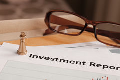 Investment Report letter document and eyeglass; document is mock Royalty Free Stock Photos