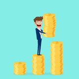 Investment and saving concept. Businessman holding gold coin and putting in the pile. Increasing capital and profits. Royalty Free Stock Images
