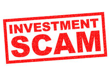 INVESTMENT SCAM. Red Rubber Stamp over a white background Royalty Free Stock Image