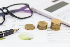Investment for stack of coins on paper analyze financial graph with calculate. Investment and Saving Concept Stock Image