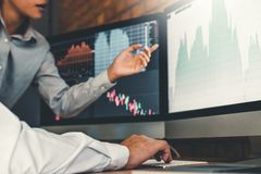 Investment stock market Entrepreneur Business Team discussing and analysis graph stock market trading,stock chart concept royalty free stock photography