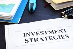 Investment strategies and folder with business documents. stock photo