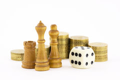 Investment strategy. Chess, coins and white cube. Business concept Stock Images