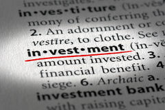 Investment text and definition. Macro of investment text with shallow depth of field