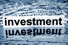 Investment text on grunge background Royalty Free Stock Photography