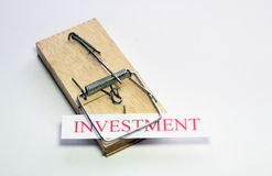 Investment trap. A mouse trap that has trapped investment. A trap that people investing money can get caught in Royalty Free Stock Photography