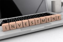 Investment text concept. Investment - wooden letters on notebook computer - 3d render illustration Stock Photography