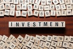 Investment word concept on cubes stock images