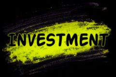 Investment word with glow powder Royalty Free Stock Images