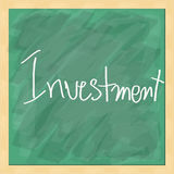 Investment write on blackboard Stock Image