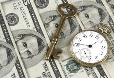 Investments. Pocket Watch, US Currency, And Skeleton Key portray the concepts of investment and keys to success Royalty Free Stock Photo