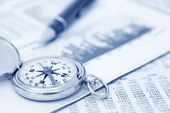 Investments. Compass and papers about financial issues Royalty Free Stock Photo