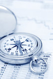 Investments. Compass and papers about financial issues Royalty Free Stock Photos