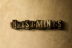 INVESTMENTS - close-up of grungy vintage typeset word on metal backdrop Royalty Free Stock Photo