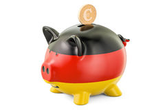 Investments in Germany. Piggy bank with flag and golden coin Royalty Free Stock Image