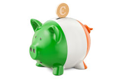 Investments in Ireland. Piggy bank with flag and golden euro coi Royalty Free Stock Images
