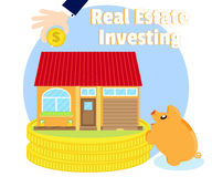Investments in real estate. Purchase of beautiful house. Businessman's hand with a gold coin. Pig piggy bank near coins Stock Photography