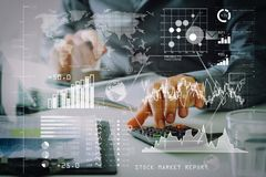 Businessman hand working with finances about cost and calculator. Investor analyzing stock market report and financial dashboard with business intelligence (BI Royalty Free Stock Image