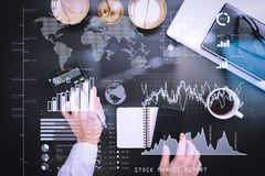 Justice and law concept.businessman or lawyer or accountant work. Investor analyzing stock market report and financial dashboard with business intelligence (BI Stock Photo