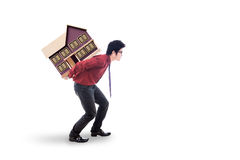 Investor carrying house model in the studio Royalty Free Stock Image