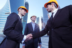 Investor and contractor shaking hands Royalty Free Stock Photo