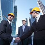 Investor and contractor shaking hands. View from below royalty free stock images