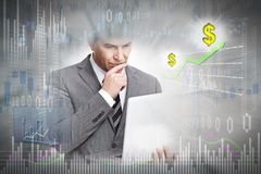 Investor with laptop computer. Stock market trading man with laptop on gray chart background Stock Image