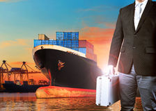 Investor man and container ship loading in import - export harbo Stock Photos