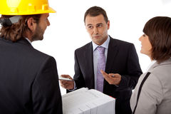 Investor setting goals. Contractor and investor discussion over plans, group of three Stock Photo