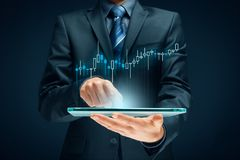 Investor and trader. Concept - investor with tablet and tradeview graph royalty free stock photos