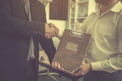 Investors are choosing to invest in good return investment. Businessmen shaking hands After successfully completing the investment and life insurance contract at stock photography