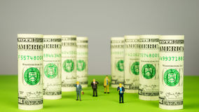Investors and dollar towers Royalty Free Stock Photography