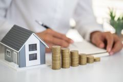 Investors signed a contract,  Buying and selling real estate. Property investment and house mortgage financial concept,  Copy