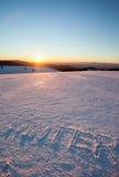Invierno de la palabra escrito en nieve Foto de archivo libre de regalías