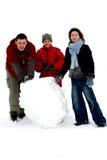 Invierno - fabricación del muñeco de nieve 2 imágenes de archivo libres de regalías