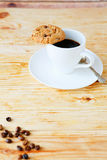 Invigorating cup of coffee and cookies Stock Photos