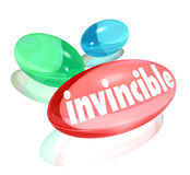 Invincible Vitamins Ultimate Strength Supplements. Invincible word on three vitamins to illustrate stronger power and energy boost you get from a natural Stock Image