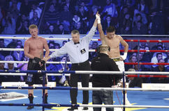 The Invincibles 6 Boxing Gala. The referee raises Ronald Gavril's hand at the end of The Invincibles 6th boxing gala professional match at super-middle weight Stock Image