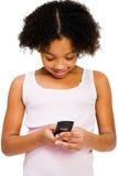 Invio di messaggi di testo della ragazza immagine stock libera da diritti