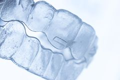 Invisible bracket teeth aligners royalty free stock photos