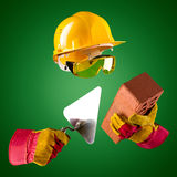 Invisible builder — trowel and brick Stock Images