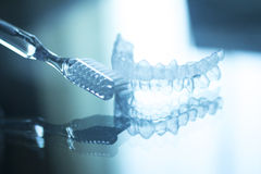 Invisible dental teeth brackets aligners retainers and toothbrus stock photos