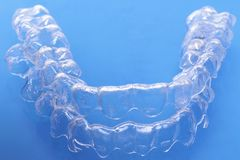 Invisible dental teeth brackets tooth aligners plastic braces dentistry retainers to straighten teeth stock image
