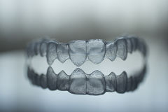 Invisible dental teeth brackets tooth plastic braces Royalty Free Stock Images