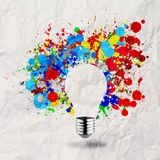Invisible light bulb and splash. Colors on crumpled paper as creative concept Royalty Free Stock Photos