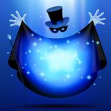 Invisible magician. In top hat  and mask with black cloak performing a magic act with blue luminous cloud. Wizard art. There is in addition a vector format (EPS Stock Images