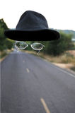 The Invisible Man. An invisible man walking down the road wearing only a hat and a pair of glasses Stock Images