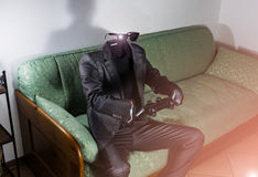 Invisible man. Invisible business man playing video games Royalty Free Stock Photos